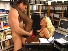 The boss fucks his gorgeous blonde office secretary in her desk