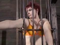 Tough beauty is hoisted up and given slit torment