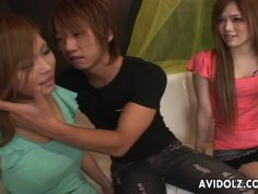 One guy gets lucky with two drunk Asian hotties on the couch