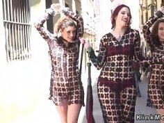 Two female slaves in femdom walked in public
